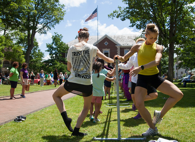 Chelsea Dumas, left, and Lexi Johnston, dancers with the Charlotte Ballet, demonstrate movements during Sunday's Barre on Bestor Plaza on July 9, 2017. ERIN CLARK / STAFF PHOTOGRAPHER
