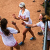 Lily Nagle, left, high fives fellow Grilled Cheeselers Katie Good, center, and Sophia Lehrman during the Women's Softball Championships at Sharpe Field on Thursday, August 3, 2017. ERIN CLARK / STAFF PHOTOGRAPHER
