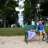Lexi Hall, 4, of Hudson, Ohio, sits on a bench to keep her feet from touching the sand at the Children's Beach on the grounds of Chautauqua Lake on Monday, June 19, 2017. Hall's family is visiting the Chautauqua Instiution for the first time with some of their family friends. ERIN CLARK / STAFF PHOTOGRAPHER