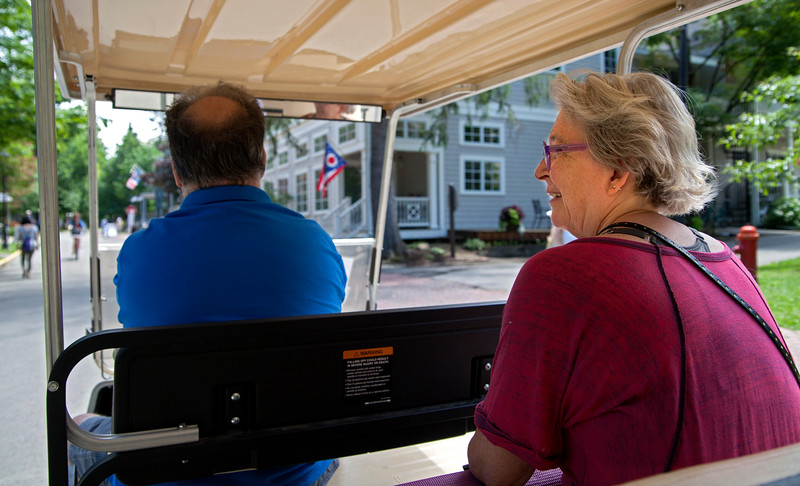 Carol Ramsey, of Los Angeles, CA, rides on the tram on Monday, July 3, 2017. Ramsey, who has been coming to Chautauqua since the 1950's, often rides the tram around the grounds just for fun. ERIN CLARK / STAFF PHOTOGRAPHER