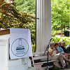 "Maureen Ryan Griffin reads ""What the Living Do"" by Marie Howe during the Favorite Poem Project at the Hall of Philosophy on Wednesday, August 2, 2017. ERIN CLARK / STAFF PHOTOGRAPHY"
