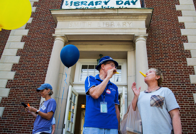 Richard Heitzenrater and Joyce Olson take part in Library Day on the steps of Smith Memorial Library on Thursday, July 20, 2017. Kazoos were passed around and chautauquans were encouraged to take part in various songs conducted by Steven Osgood. ERIN CLARK / STAFF PHOTOGRAPHER