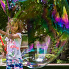 Daisy Masters, seven, of Houston, Texas, creates bubbles on Bestor Plaza on Wednesday, June 28, 2017.  Daisy has been coming to Chautauqua since she was born. ERIN CLARK / STAFF PHOTOGRAPHER