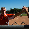 John Chubb high fives a team member after scoring a run during the Slugs softball game on Monday, July 17, 2017. ERIN CLARK / STAFF PHOTOGRAPHER