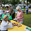 "Jeannette Kahlenberg, right, purchases Mary Anne Morefield's second published book, ""No bridle, no bits, no reigns"" at The Chautauqua Literary Arts Friends book fair on Bestor Plaza on Sunday, July 9, 2017. ERIN CLARK / STAFF PHOTOGRAPHER"