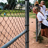 Ellie Rappole watches fellow members of The Grilled Cheeselers during their game at Sharpe Field on Thursday, August 3, 2017. ERIN CLARK / STAFF PHOTOGRAPHER