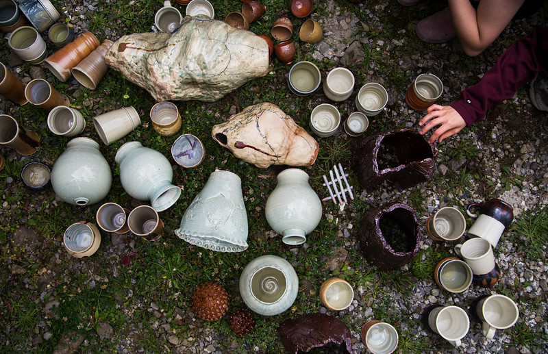 Sara Mays, a VACI School of Art Student, examines ceramic pieces recently pulled from the kiln on Friday, June 15, 2017.  ERIN CLARK / STAFF PHOTOGRAPHER