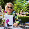 "Author Janay Cosner sells her book at The Chautauqua Literary Arts Friends book fair on Bestor Plaza on Sunday, July 9, 2017. Cosner wrote ""Dancing with Breast Cancer"", a collection of poems, during her own battle with breast cancer. ERIN CLARK / STAFF PHOTOGRAPHER"