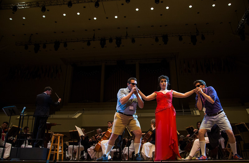 "From left, Mario Diaz-Moresco, Chelsea Friedlander, and Arnold Livingston Geis perform W.A. Mozart's ""Alla bella Despinetta"" from ""Cosi fan tutte"" at the Chautauqua Symphony Orchestra Opera Highlights Concert in the Amp on Saturday, July 15, 2017. ERIN CLARK / STAFF PHOTOGRAPHER"
