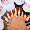 Members of the Grilled Cheeselers pose for a photo after winning the Women's Softball Championship at Sharpe Field on Thursday, August 3, 2017. Many members on the team play without shoes. ERIN CLARK / STAFF PHOTOGRAPHER