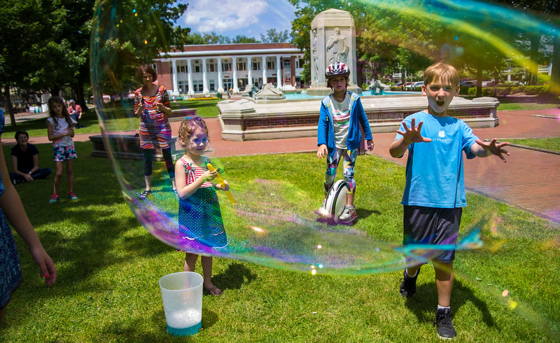 Children play with bubbles on Bestor Plaza on Wednesday, June 28, 2017. ERIN CLARK / STAFF PHOTOGRAPHER