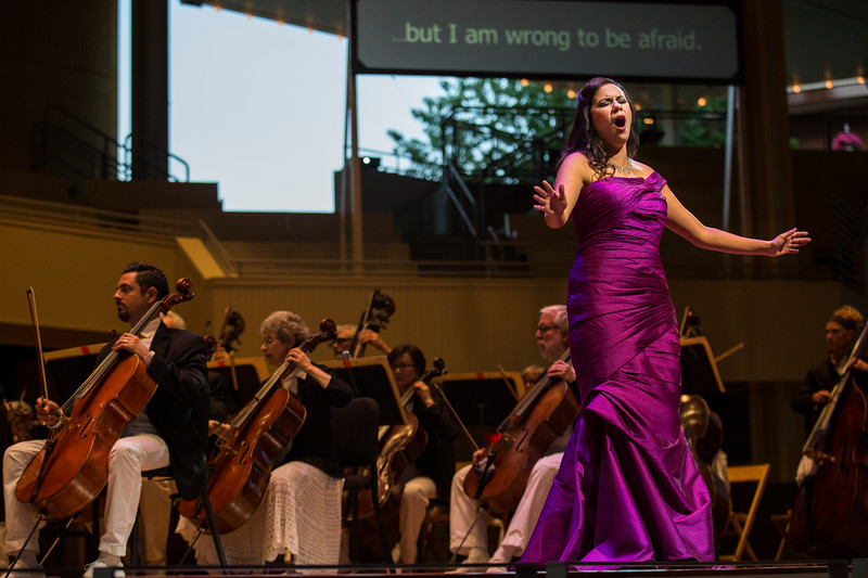 """Laura Soto-Bayomi performs Georges Bizet's """"Je dis que rien ne m'epouvante from """"Carmen"""" at the Chautauqua Symphony Orchestra Opera Highlights Concert conducted by Steven Osgood in the Amp on Saturday, July 15, 2017. ERIN CLARK / STAFF PHOTOGRAPHER"""