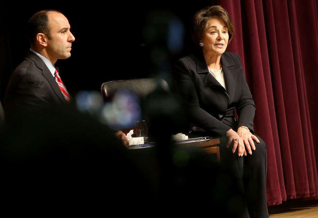 . Reps. Jimmy Panetta and Anna Eshoo take questions from Santa Cruz County residents during a town hall meeting at New Brighton Middle School on Saturday. Questions ranged from concerns about immigration to healthcare and net neutrality. (Kevin Johnson -- Santa Cruz Sentinel)