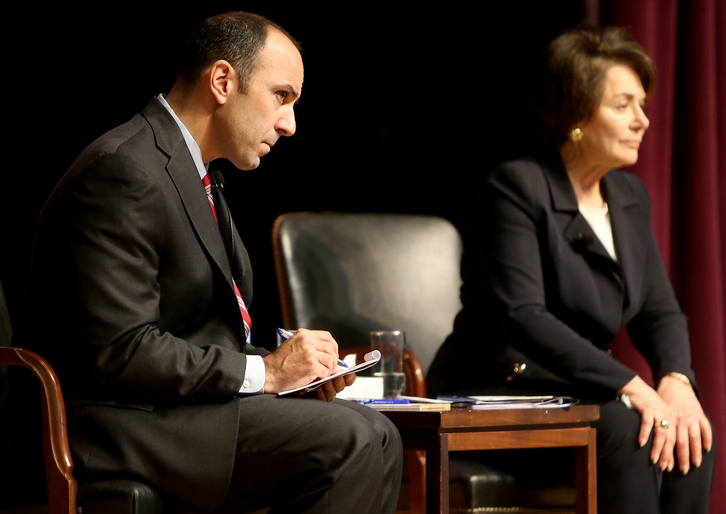 . Reps. Jimmy Panetta, left, and Anna Eshoo listen to Santa Cruz County residents during a town hall meeting at New Brighton Middle School in Capitola on Saturday. (Kevin Johnson -- Santa Cruz Sentinel)