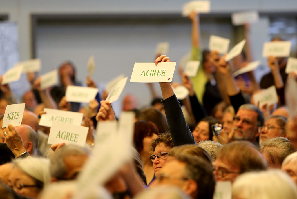 . Constituents of California representatives Ana Eshoo and Jimmy Panetta voice their opinions on issues using signs during a town hall meeting at New Brighton Middle School in Capitola on Saturday. (Kevin Johnon -- Santa Cruz Sentinel)