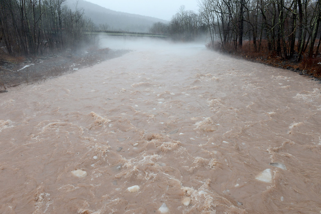 . Tania Barricklo-Daily Freeman   Large chunks of ice float dowqn a swollen Esopus Creek in Phoenicia Friday where water was high due to rain and snowmelt.