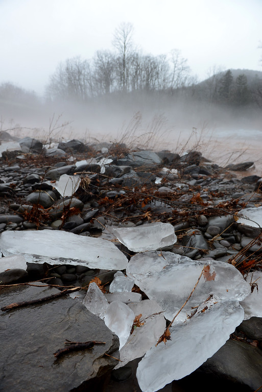 . Tania Barricklo-Daily Freeman Large chunks of ice collect on the banks of the Esopus Creek in Phoenicia Friday.