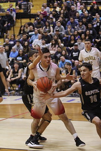 Española's JP Sena, number 10, is double teamed by Capital's Aaron Garcia, number 32, and Tyler Alarid, number 10, during the first quarter of the Española Valley High School vs Capital High School boys basketball game at Española on Tuesday, January 23, 2018. Luis Sánchez Saturno/The New Mexican