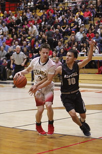Capital's Tyler Alarid, number 10, covers Española's Christian Fernandez, number 3, during the first quarter of the Española Valley High School vs Capital High School boys basketball game at Española on Tuesday, January 23, 2018. Luis Sánchez Saturno/The New Mexican
