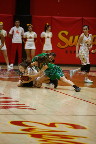 Española's Jasmine Baca, number 13, recovers a loose ball from Pojoaque's Alicia Sanchez, number 10, during the first quarter of the Española Valley High School vs Pojoaque Valley High School at Española on Tuesday, January 22, 2019. Luis Sánchez Saturno/The New Mexican