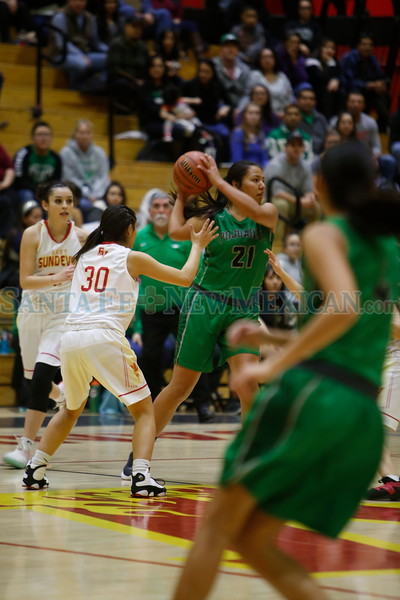 Española's Kaylee Chavez, number 30, covers Pojoaque's Ashton Martinez, number 21, during the first quarter of the Española Valley High School vs Pojoaque Valley High School at Española on Tuesday, January 22, 2019. Luis Sánchez Saturno/The New Mexican