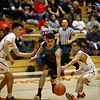 Española's Brian Martinez, number 10, and Luis Molina, number 5, double team Taos' Abdul Khweis, number 21, during the second quarter of the Española Valley High School vs Toas High School boys basketball game at Española on March 1, 2019. Luis Sánchez Saturno/The New Mexican