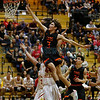 Taos' Justin Madrid, number 3, makes a lay-up over Española's Justino Rascon, number 44, during the second quarter of the Española Valley High School vs Toas High School boys basketball game at Española on March 1, 2019. Luis Sánchez Saturno/The New Mexican