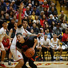 Española's Justino Rascón, number 44, covers Taos' Naah Armijo, number 42, during the second quarter of the Española Valley High School vs Toas High School boys basketball game at Española on March 1, 2019. Luis Sánchez Saturno/The New Mexican