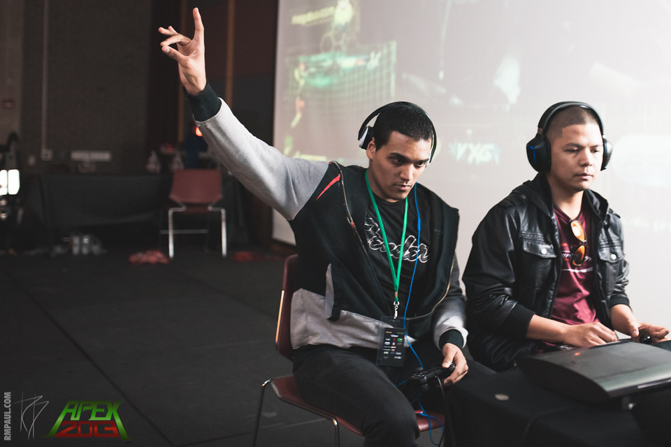 "Joshua ""JRosa"" Rosa (L) acknowledges the crowd's excitement during a close Ultimate Marvel vs Capcom 3 match against Complexity Gaming's Ryan ""Filipino Champ"" Ramirez (R)."