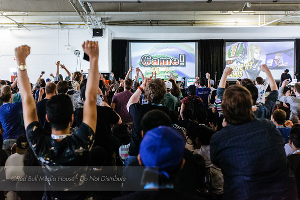 Spectators react to a Super Smash Bros. Melee match at Get On My Level in Toronto, Ontario on May 21, 2016.