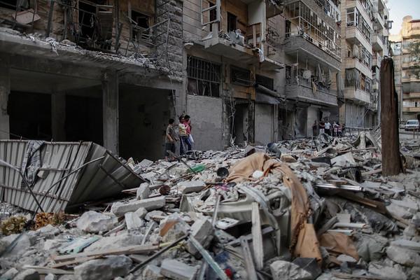 ALEPPO - SEPTEMBER 2012: Debris from a recent airstrike blocks a street in a residential neighbourhood.