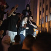 BEIRUT -  OCTOBER 2019: An anti government protester tries to placate supporters of the Hezbollah and Amal political parties, who had gathered at Riad al Solh square, a central point of the protests, after demonstrators had insulted their respective leaders, Hassan Nasrallah and Nabih Berri.<br /> <br /> This was the first manifestation of the Shiaa political parties' supporters against the popular anti government protests which would eventually descend into street brawls as relations between the two sides slowly broke down.This group and the main protest group were separated by a line of riot police as they traded chants and insults. This woman had slipped through the police line to try and find common ground between the two groups. While she found some sympathetic ears, the two groups would end up in scuffles with police, who eventually drove the counter protesters from the square.