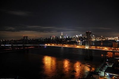 New York, NY - Unplugged.  View of the Williamsburg Bridge and the darkened lower portion of Manhattan.