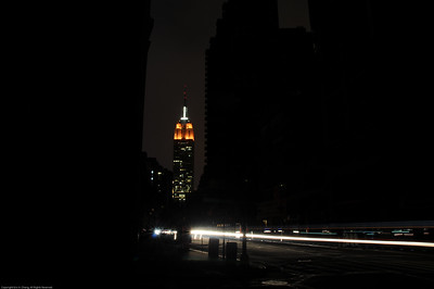 A view of the Empire State Building from the darkened streets.