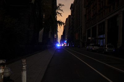 A police car passed by almost every two minutes in the darkened streets.