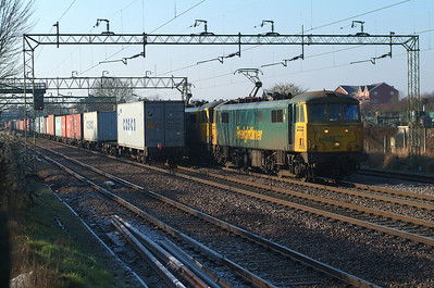 BLOCKER ,but a nice one this time as the boxes on the end wagons of the westbound Liner cover the usual four or five empty flats behind 86608+86622 on 4L89 22.01 Coatbridge FLT-Felixstowe N FLT. Witham 21.1.2017 10.50hrs.