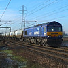 66727 Cattawade 18.1.2017 11.15hrs. 6P41 09.57 Harwich Carless Refinery-North Walsham GBRf.<br /> <br /> Possibly my last picture from here as news released yesterday , 10th Feb 2017 ,of  a new Train Maintenance Depot being constructed on the opposite side of the line from where I'm standing making access to the photo spot , already difficult  ,  impossible.<br /> I'm grateful for the shots I did get there.<br /> <br /> 22 Jan 2018...or possibly not ! Rather late in the day but seemingly discussions are now on-going about the suitability of the site for  a depot. Watch this space.<br /> ( Mask...Hoping not , but that I'll still be able to access the location! ).