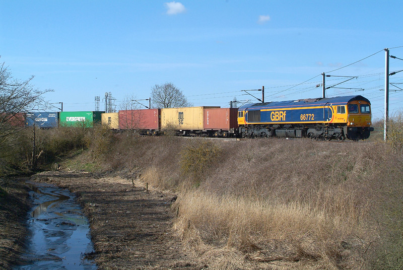 66772  Manningtree  26.3.2018 11.19hrs.. 4R03 11.02 Parkeston SS-Felixstowe N GBRf.  The train had spent the weekend stabled at Parkeston ,and now , Monday morning , takes the short journey round to Felixstowe.