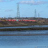 Having waited almost an hour after 66758 for a different liveried 66 and wagons, cloud arrived with seconds to go so just a quick record shot looking over the estuary towards Cattawade . <br /> 66098 12.2.2018 12.36hrs 6M57 12.07 Ipswich Griffin Wharf-Watford London Concrete.<br /> Also Top and Tailed FL66's on very nice red wagon infrastructure train Parkeston-Whitemoor  passed  just a few seconds before also  under cloud.<br /> I tried again for the sand at Witham and Terling Rd. but failed there too.<br /> Obviously not meant to be this time.