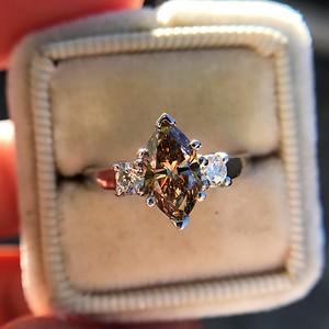 1.10ct Fancy Dark Brownish Yellow Marquise 3-Stone Ring