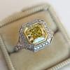 1.63ct Fancy Intense Yellow Radiant Diamond Halo Ring 14