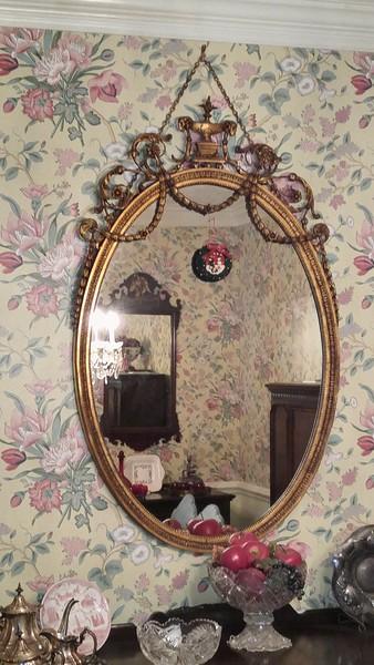 Antique round ornate French mirror