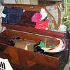 A cedar trunk full of purses (most are new with tags)