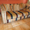 70's loveseat with pillows (VERY heavy), mainly worn on the arms  =  $175