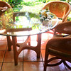 RATTAN TABLE -  clear beveled glass round Table & 3 Padded Chairs  = $200