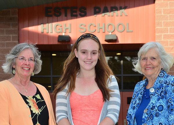 Cora Young receives $2,000 from Sylvia Adams and Betty Meyer of PEO-AV's Dorothy and James Durrett Scholarship.