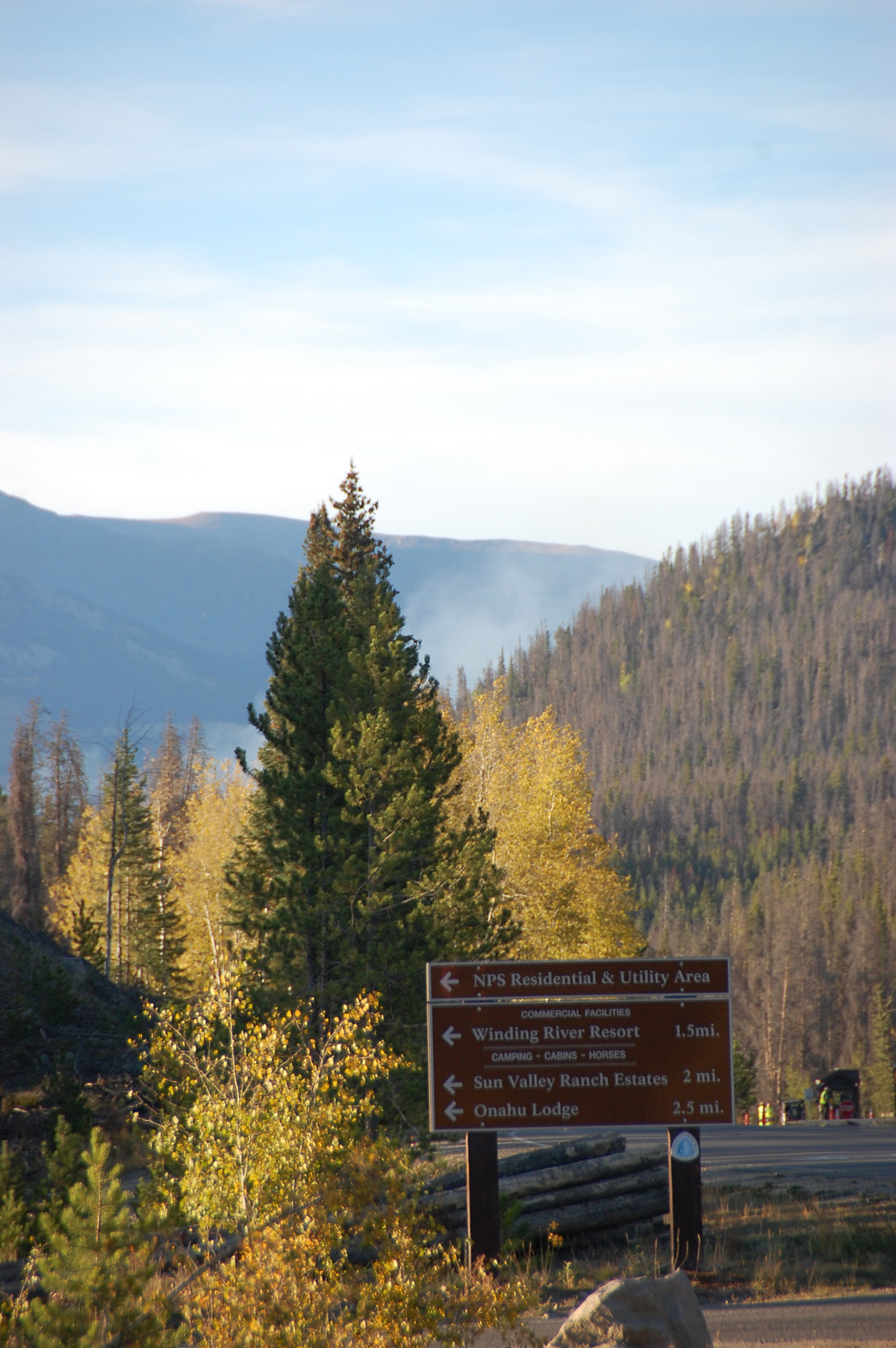 Light smoke can be seen Saturday evening from the Onahu Fire shortly after it reached the trees.