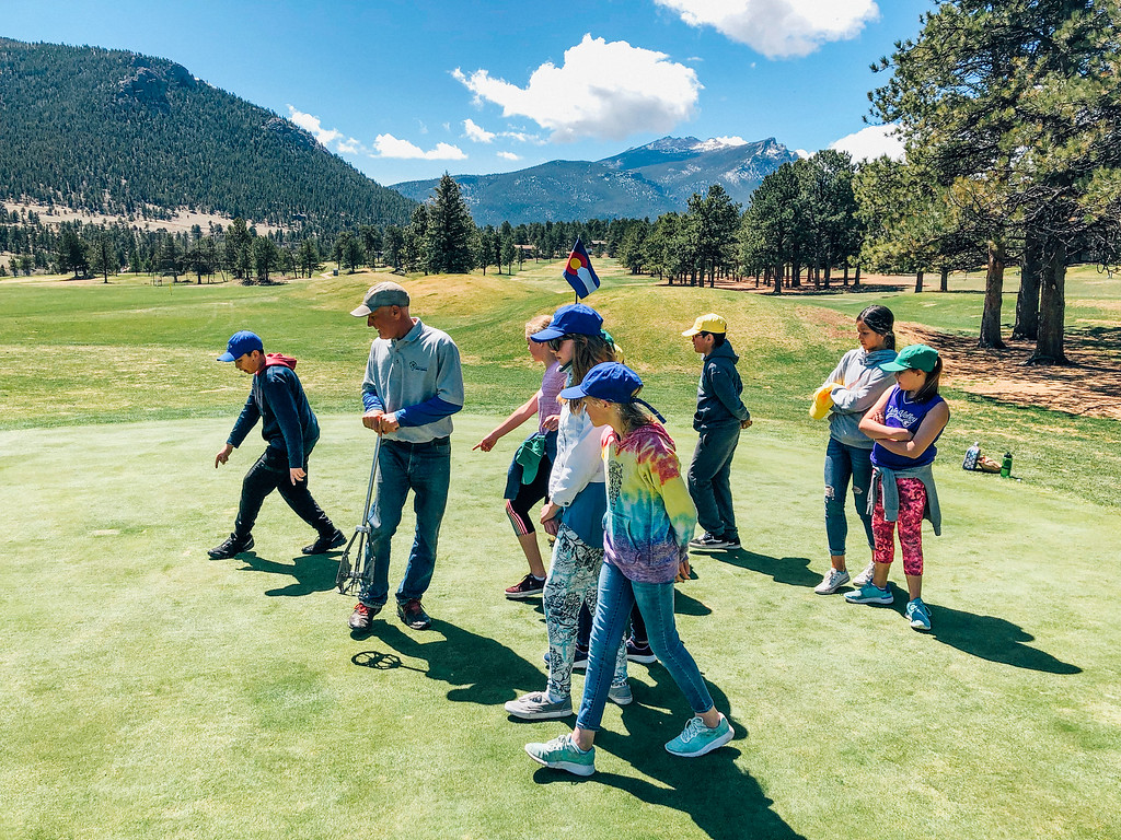 . Students learn how to repair divots on a green (Trail-Gazette)