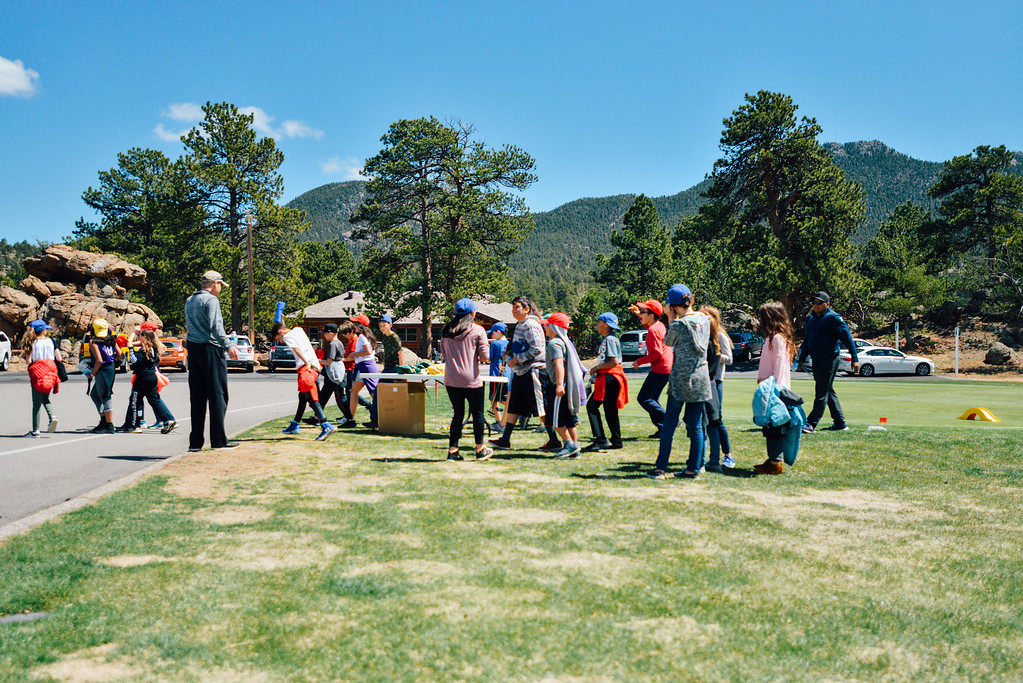 . Students head back to class after attending the First Green Event at Estes Park Golf Course, April 23, 2019. (Trail-Gazette)