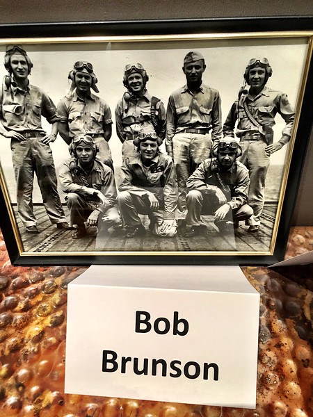 Bob Brunson_ Navy. An old photo of Brunson and his night fighting squadron was on display during a dinner celebrating Estes Park's WWII veterans